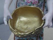 Personnage en biscuit de porcelaine avant dé-restauration